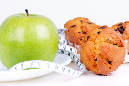Green apple and cake with tape measure, close-up